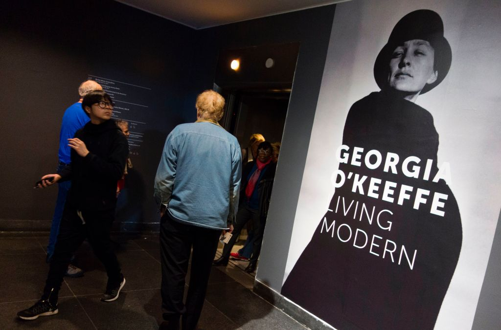 A poster outside the elevator announces the Georgia O'Keeffe exhibit