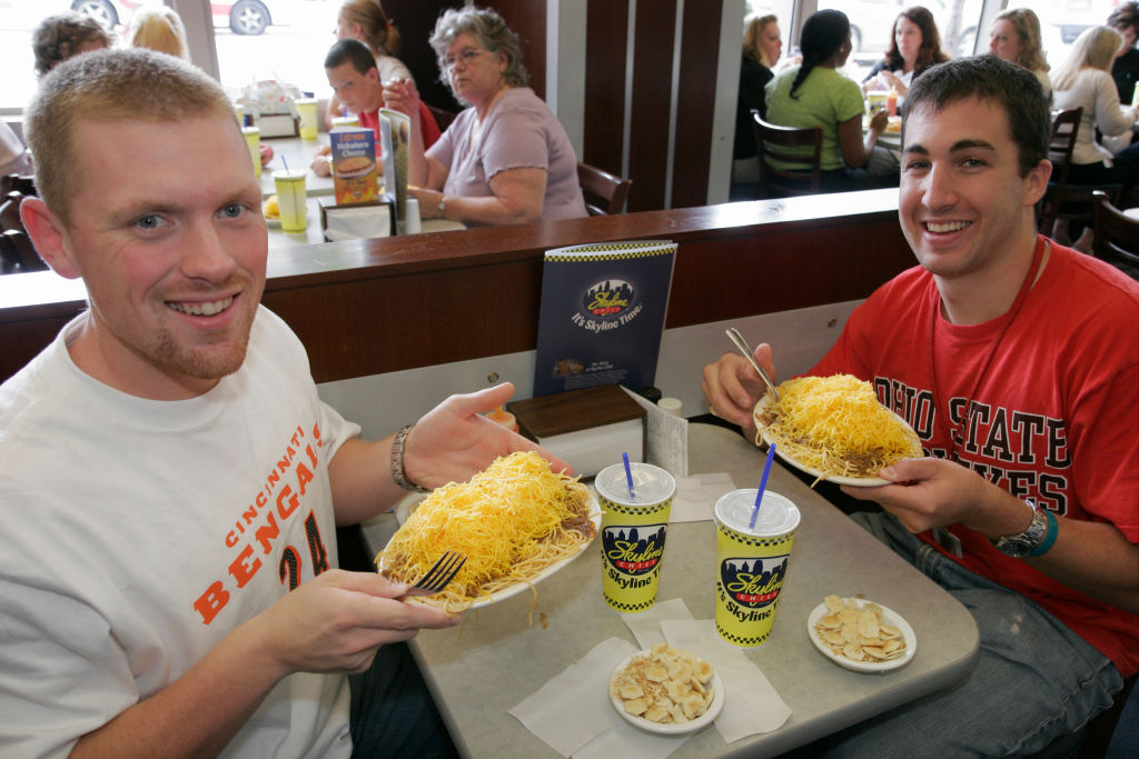 Two men with plates of food at the Skyline Chili Restaurant.