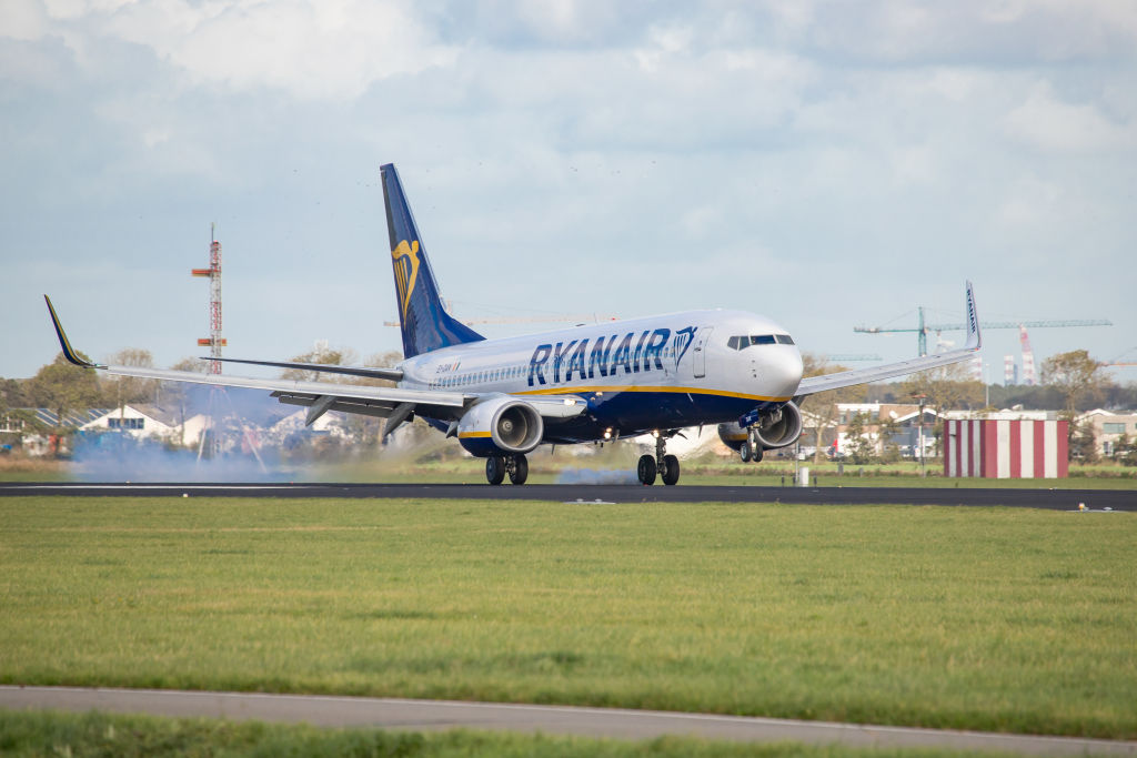 a ryanair airplane about to land on the runway