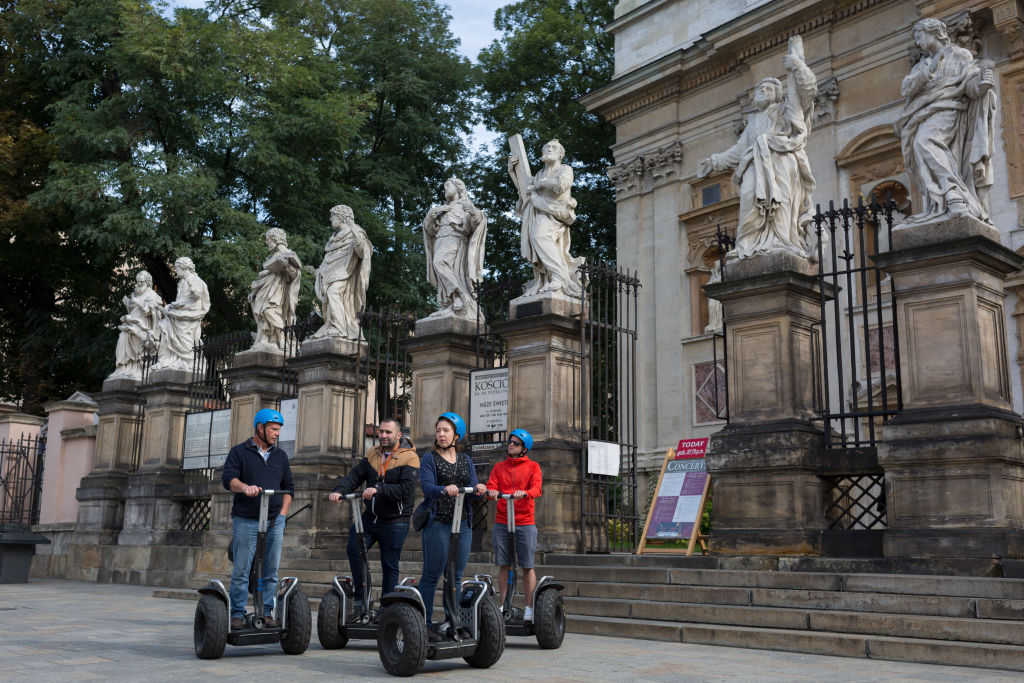 a tour group outside a church on segways