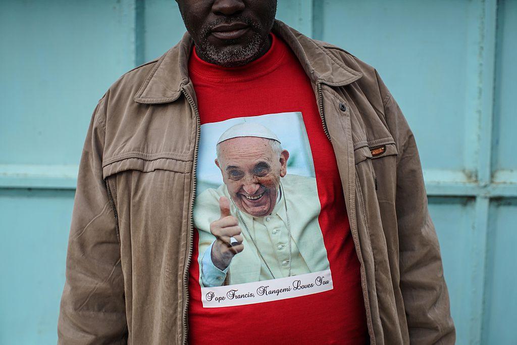 man wearing religious shirt