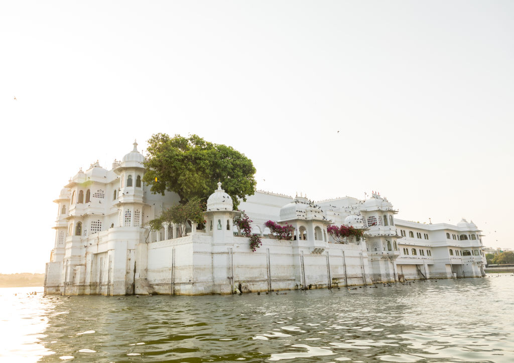 the taj lake palace hotel in a lake in Rajasthan, India