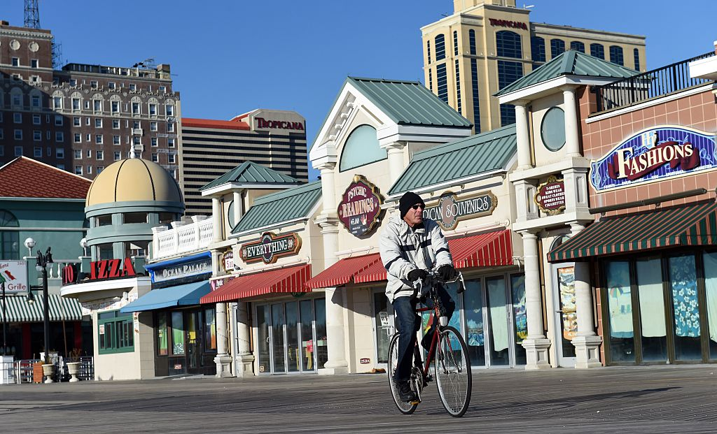 a cyclist riding along the atlantic city boardwalk