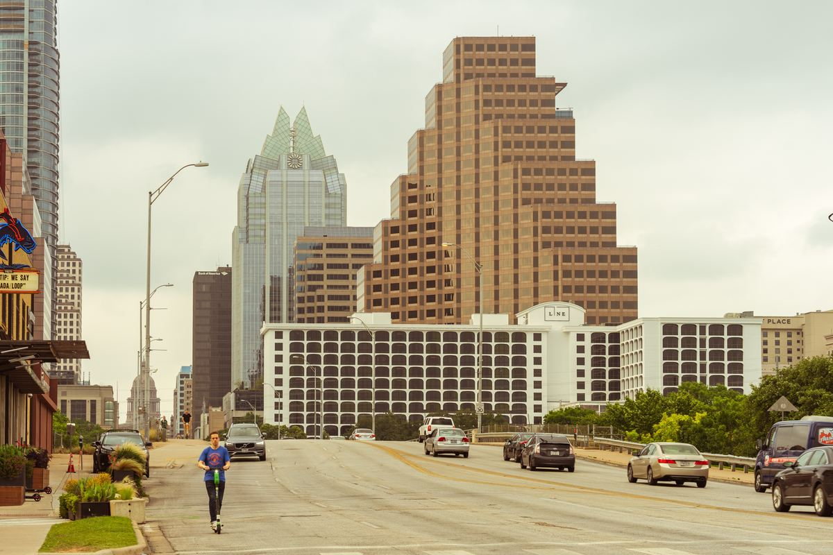 a man riding a scooter in austin, texas