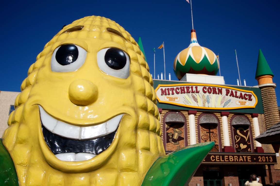 a statue of corn in front of the corn palace