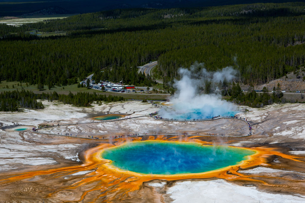 grand prismatic spring in yellowstone national park with colors of orange, yellow, green, and blue