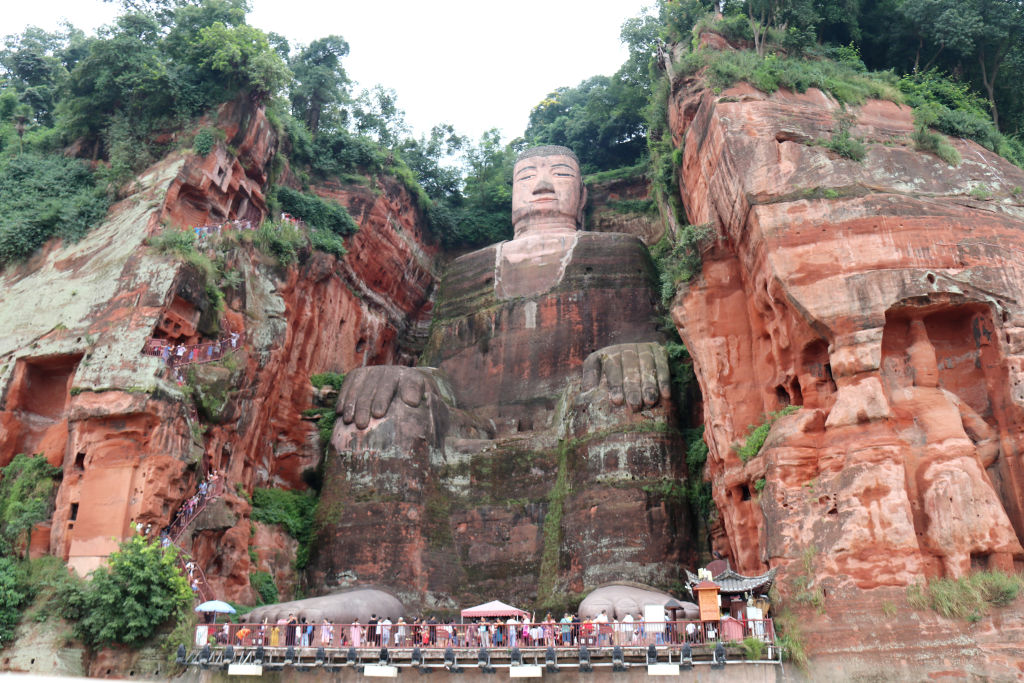 Tourists visit the Leshan Giant Buddha