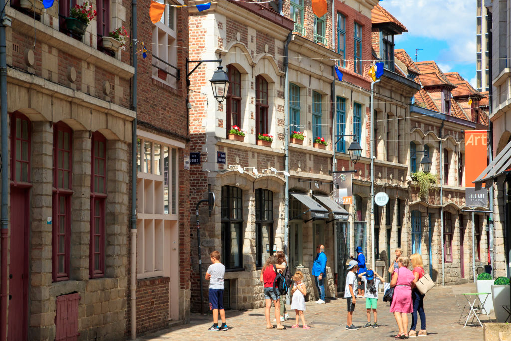 tourists in the old city of lille, france
