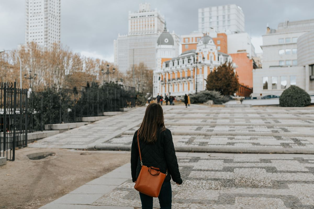 a girl looking at the city buildings in madrid, spain