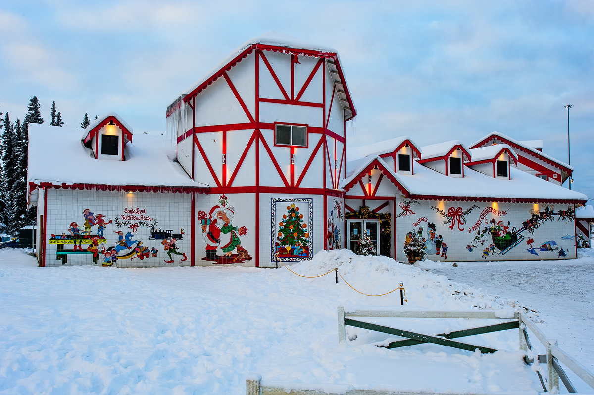 a house covered in snow and christmas decorations