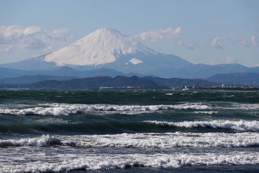 mount fuji seen from the beach in tokyo
