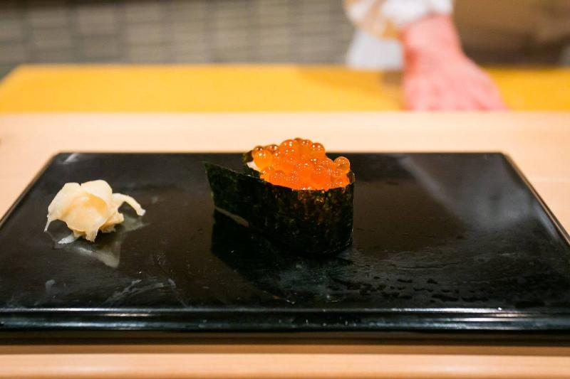 Ikura (Salmon Roe) is plated at Sukiyabashi Jiro.