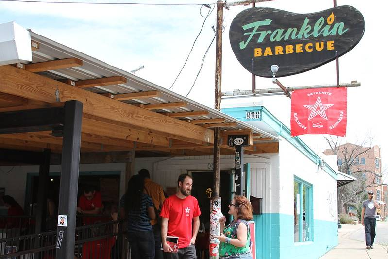 Customers stand in line at Franklin Barbecue.