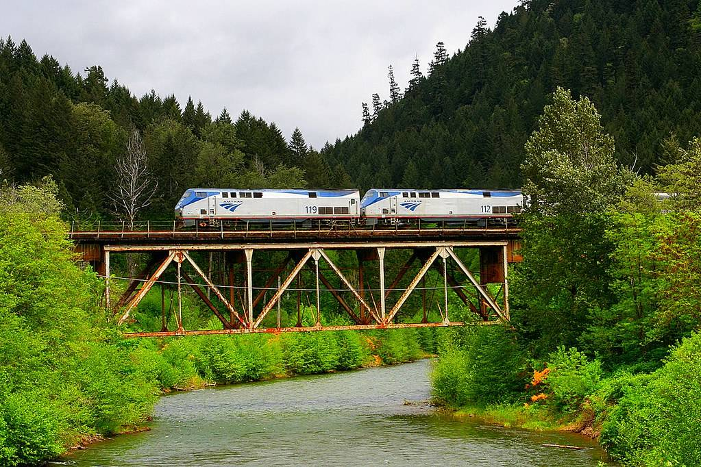 The Coast Starlight train crosses a bridge over Willamette River in Oregon.