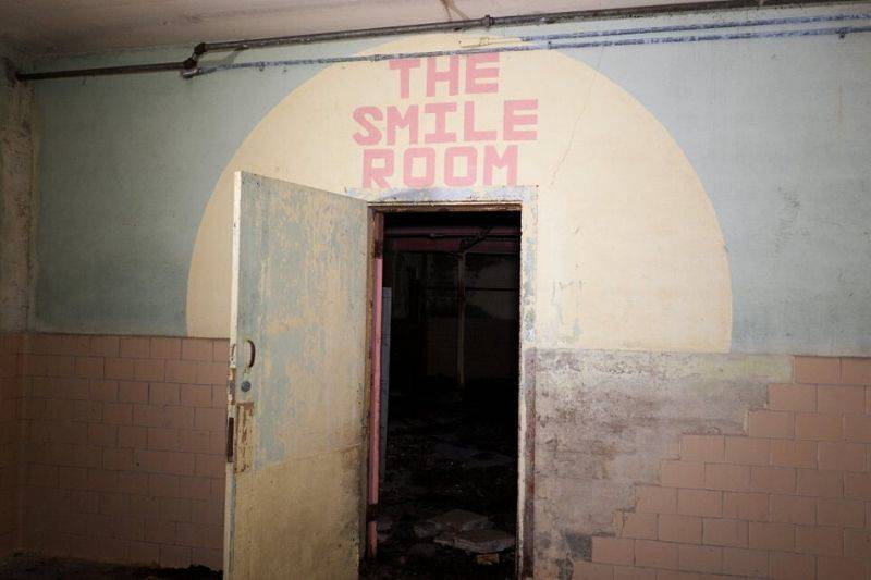 an old building that has a door that says,