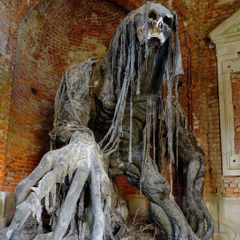 a statue in an old mausoleum in Poland