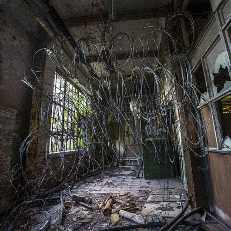 a bunch of barbed wire in an old psych hospital