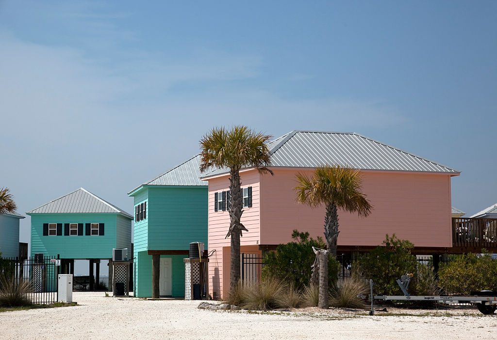 two teal houses and one pink house near the beach at Dauphin Island, Alabama