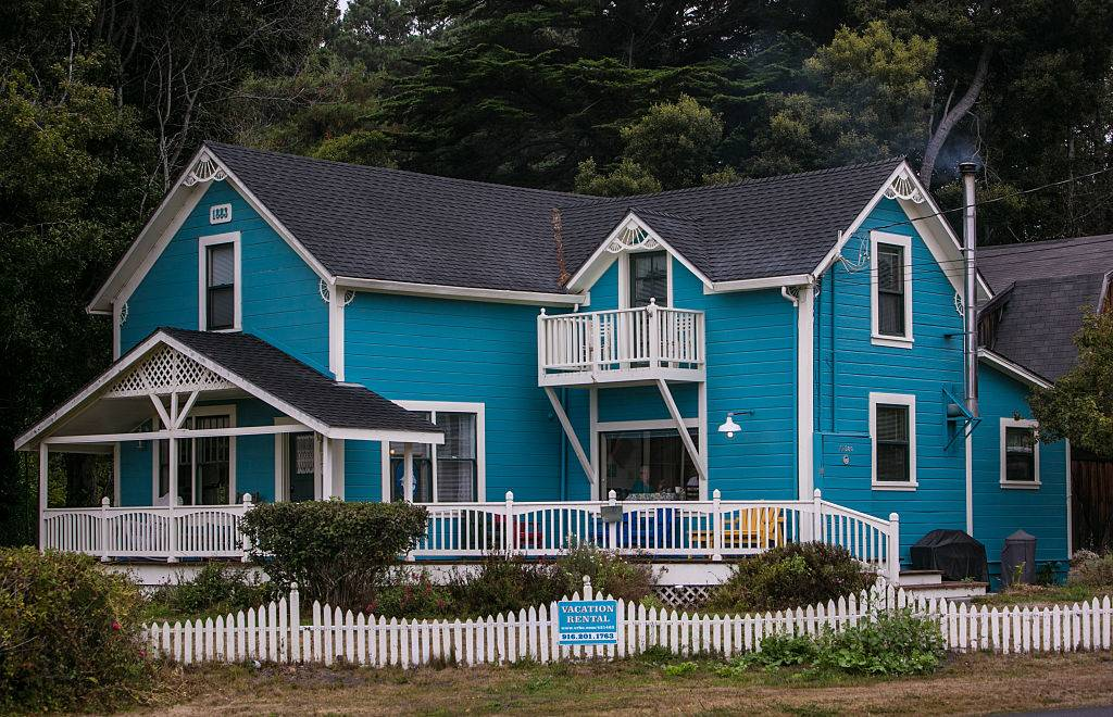 a blue house near the trees in Fort Bragg, California