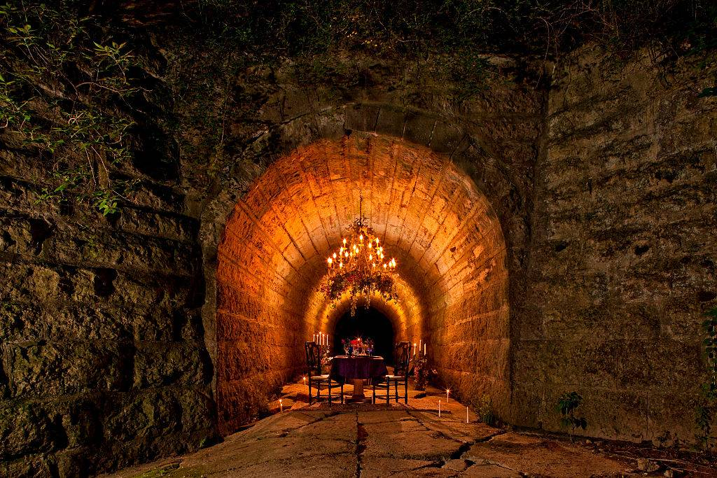 a tunnel with a table setting inside in Galena, Illinois