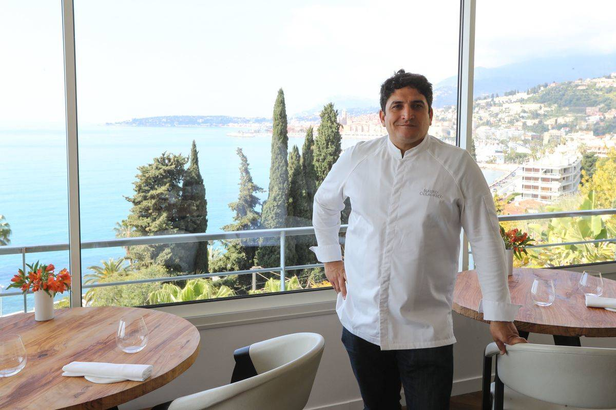 Italian-Argentinian chef Mauro Colagreco stands in front of the view at the French restaurant Mirazur.