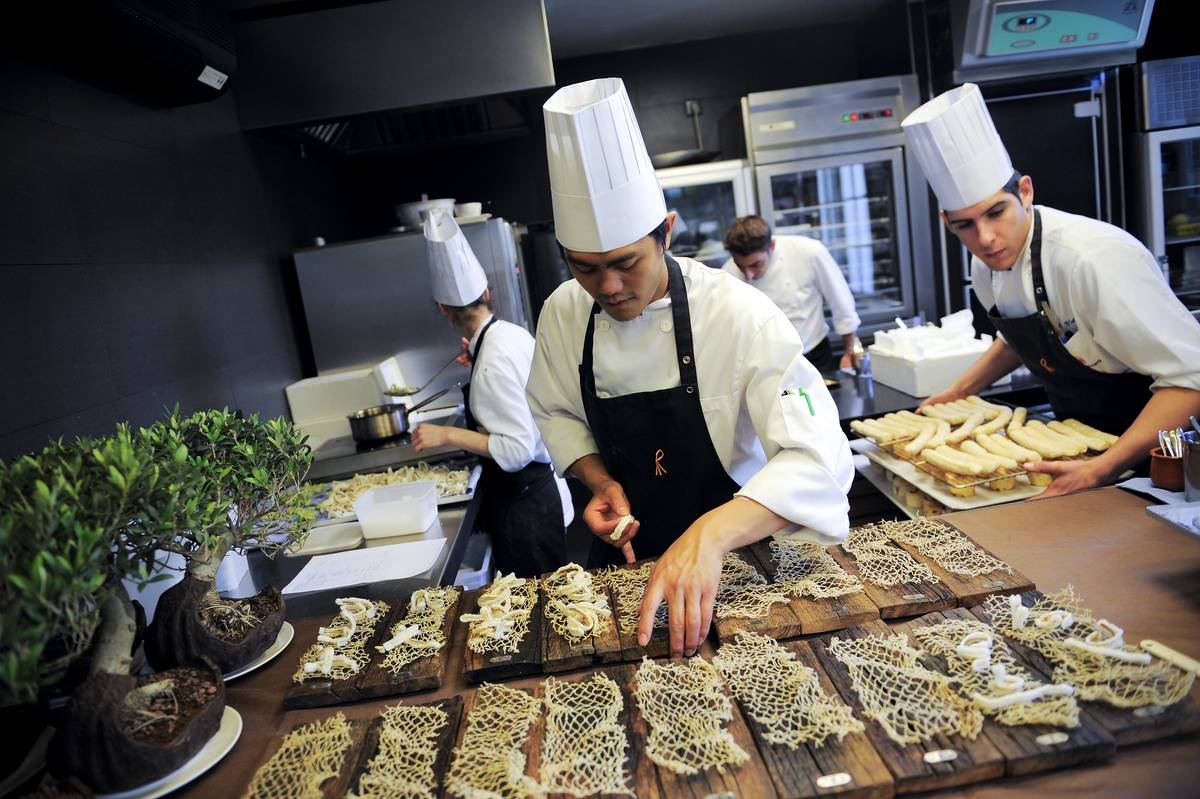 Chefs prepare dishes at the Spanish restaurant El Celler de Can Roca.