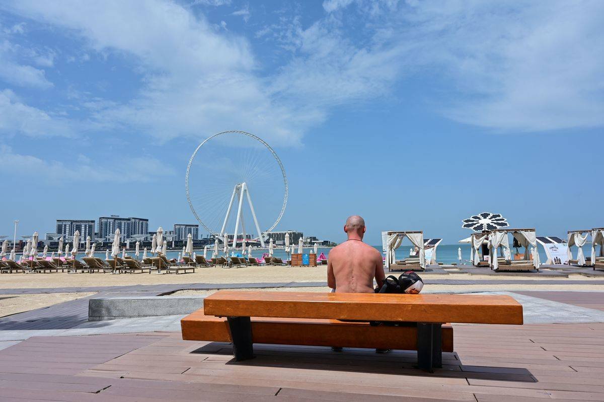 man on bench in dubai
