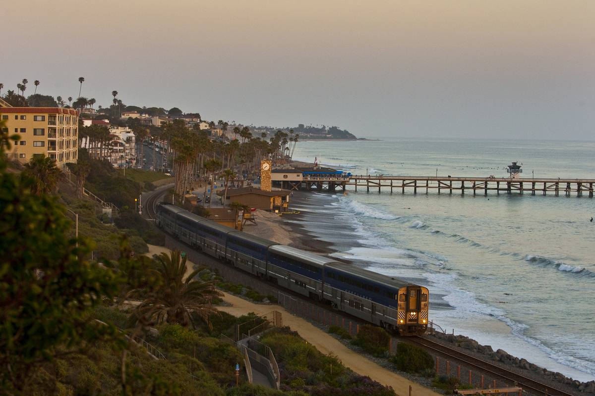 The Pacific Surfliner passes the San Clemente Pier in CA.