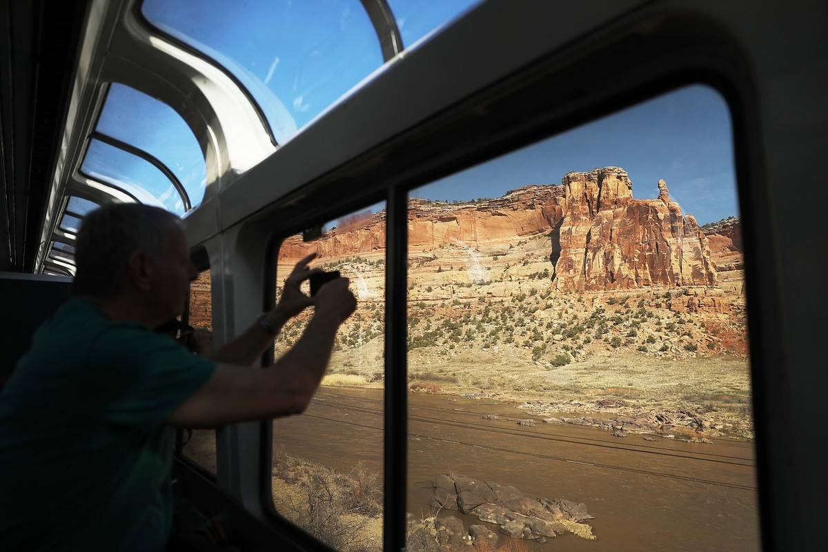 Passengers take photos of the cliffs in Utah on board the California Zephyr.