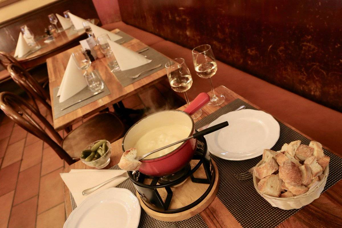 Traditional Swiss fondue is served at the restaurant in l'Hôtel De Ville.