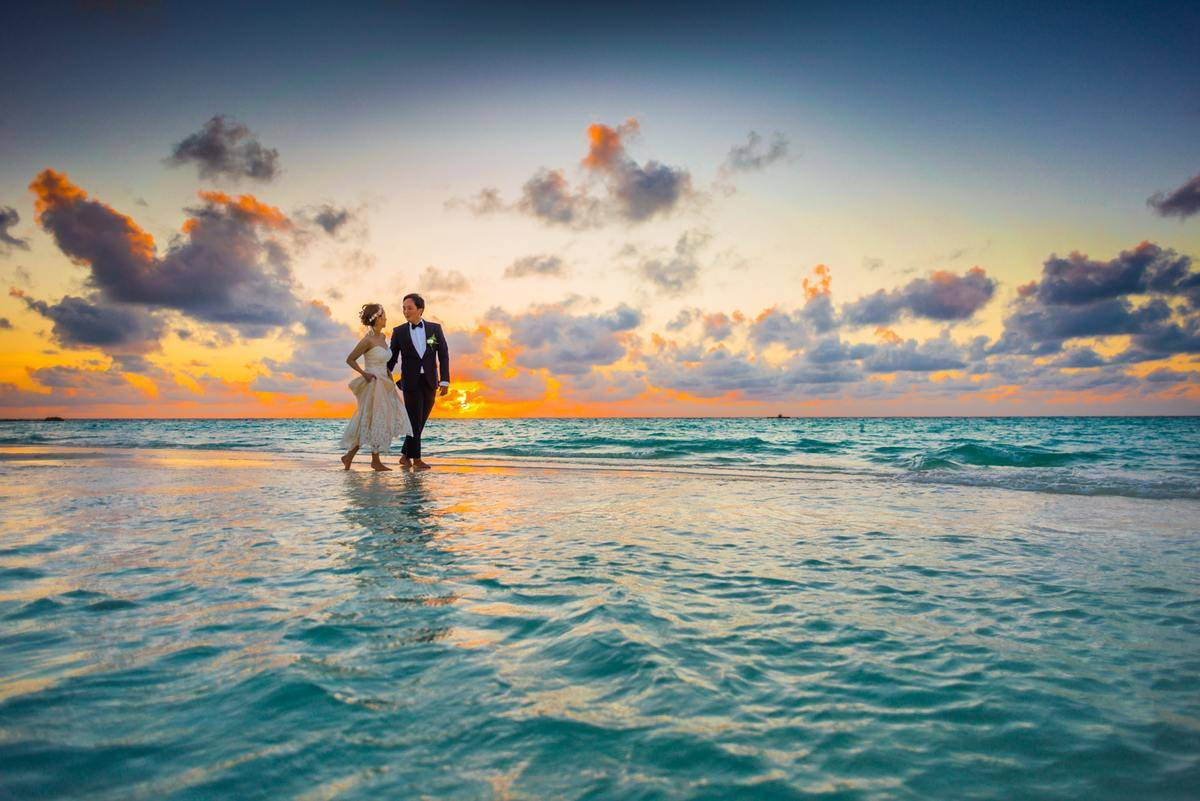 man-and-woman-walking-of-body-of-water
