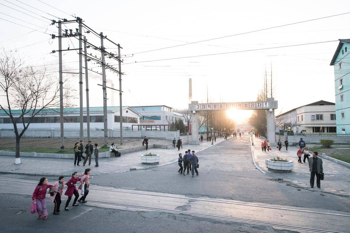 kids playing in the street in pyongyang, north korea