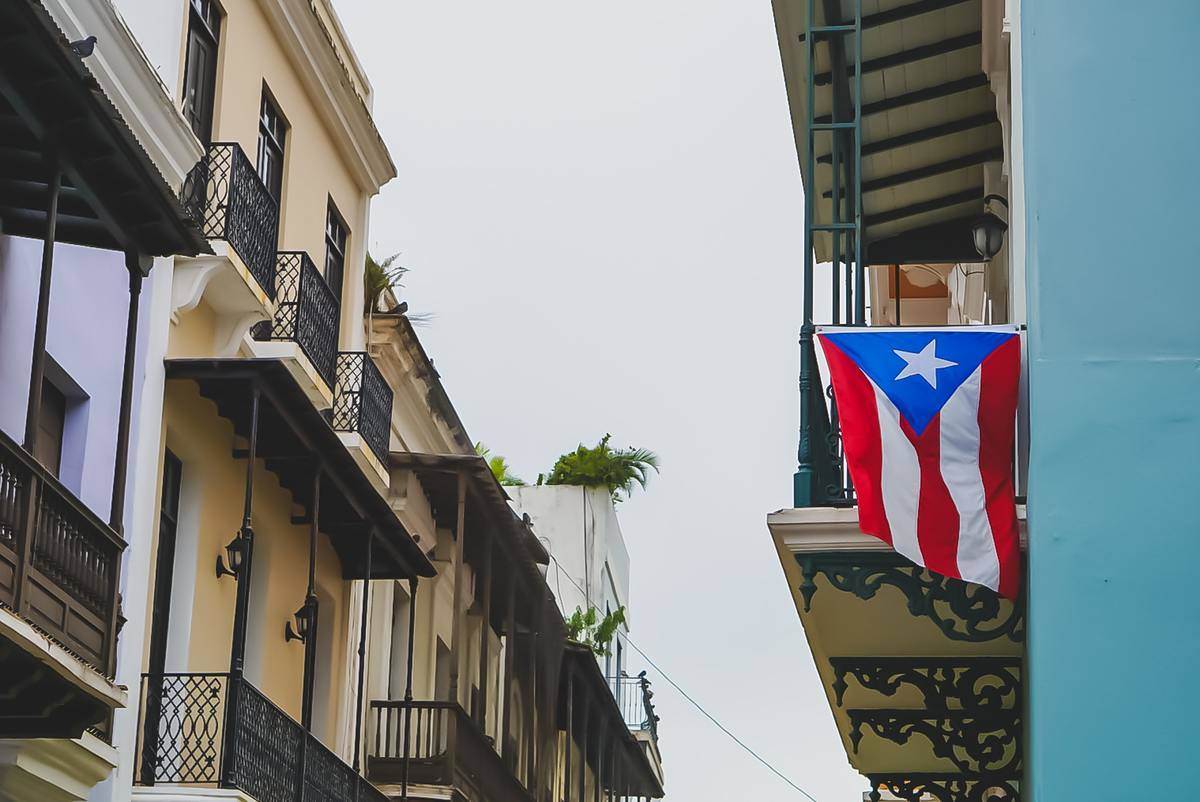the puerto rican flag hung off a building in san juan, puerto rico