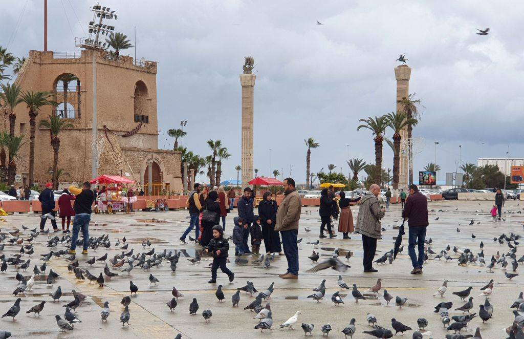 people and birds gathering in town in tripoli, libya