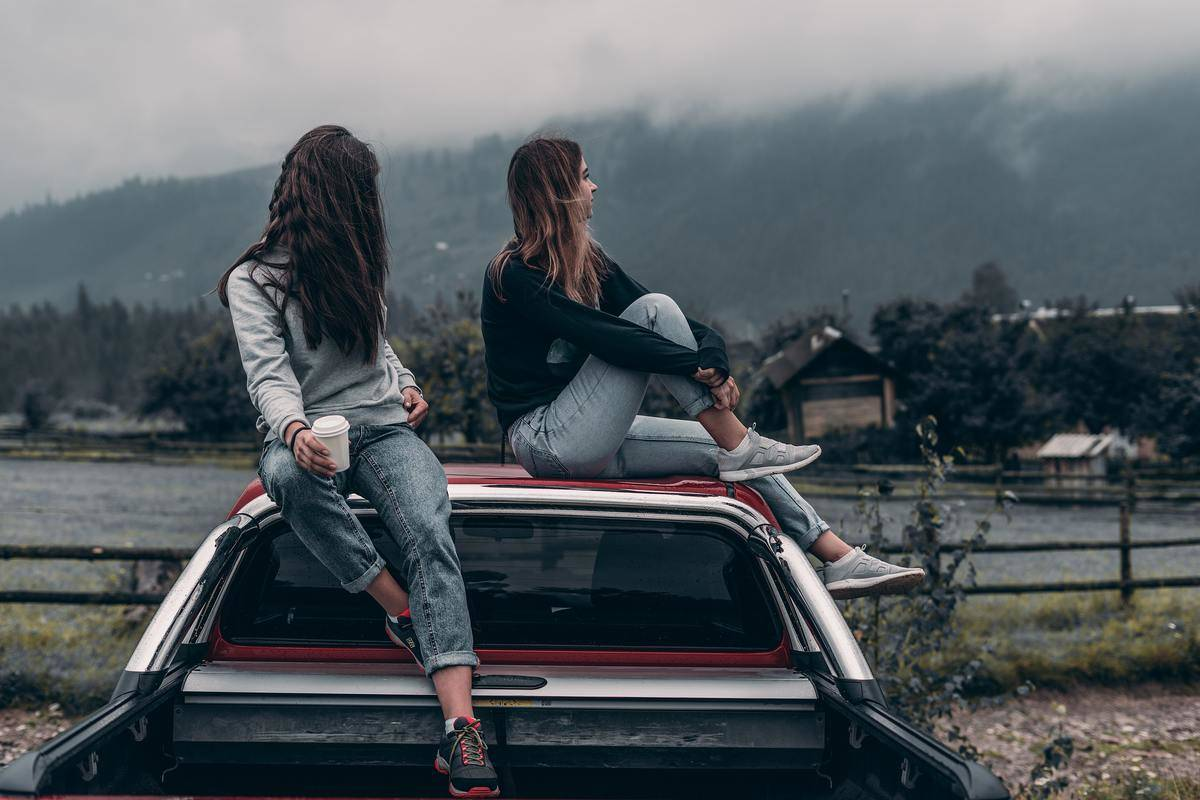 two-women-sitting-on-roadtrip