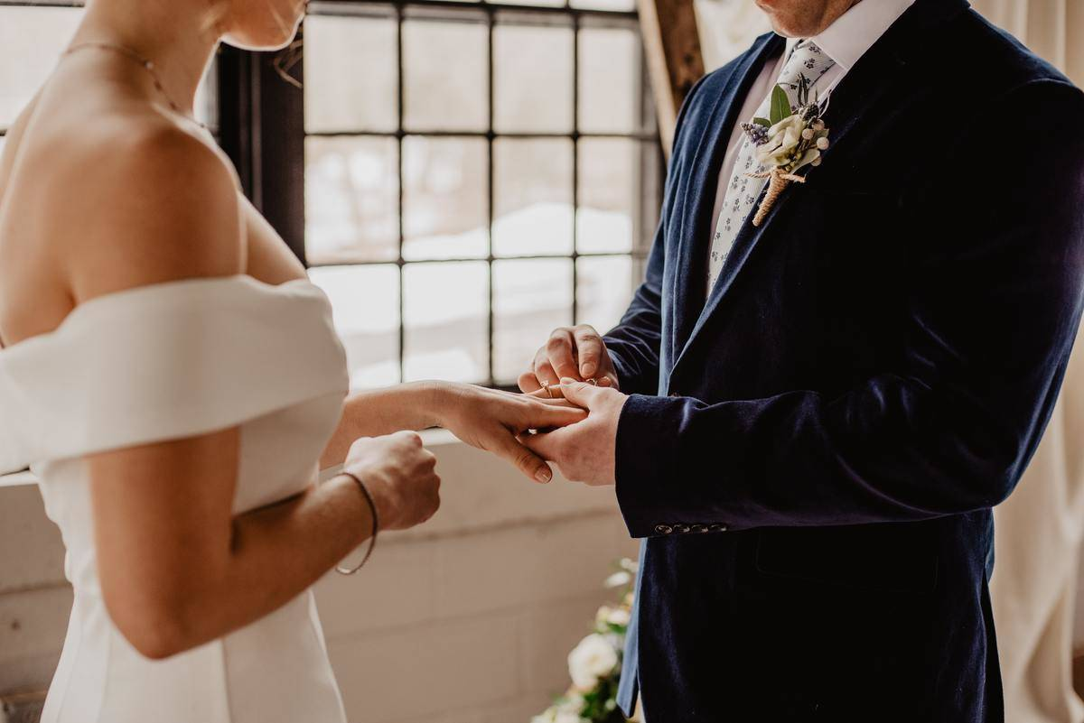 woman-and-man-holding-each-others-hands at wedding