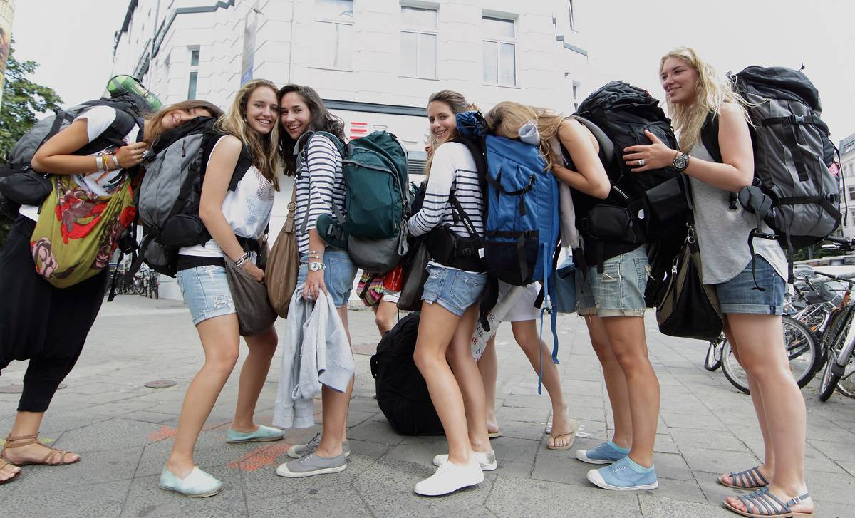 female backpackers standing together