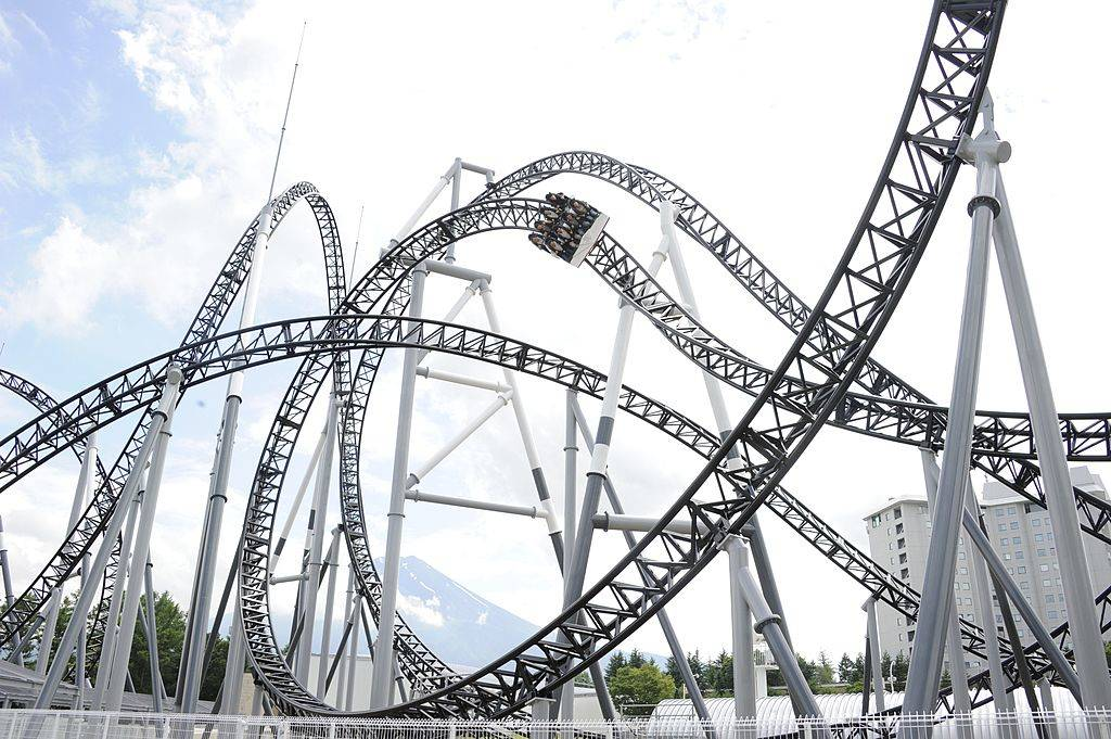People react as they ride on Fuji-Q Highland amusement park world's steepest roller coaster