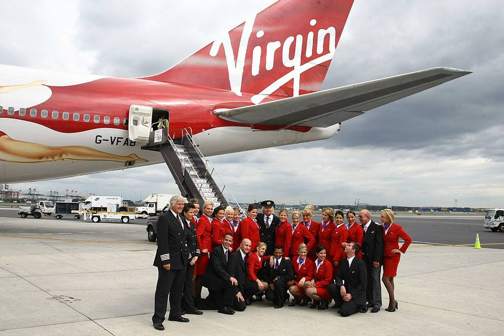 Sir Richard Branson (center) and crew members of flight VS001 pose for a photograph