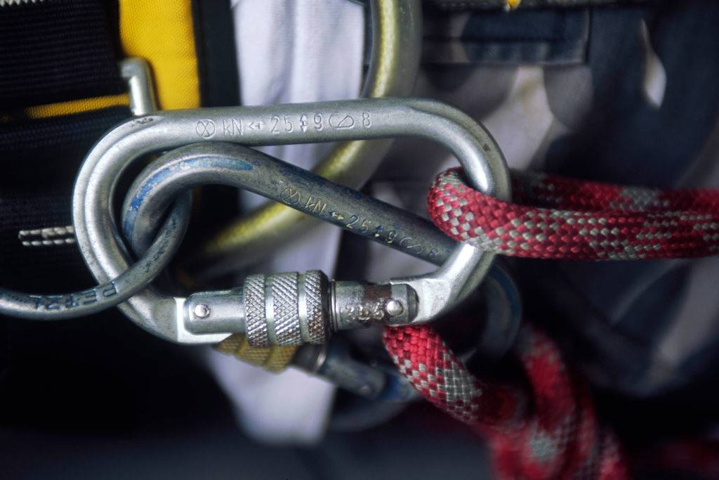a metal carabiner clip with rope