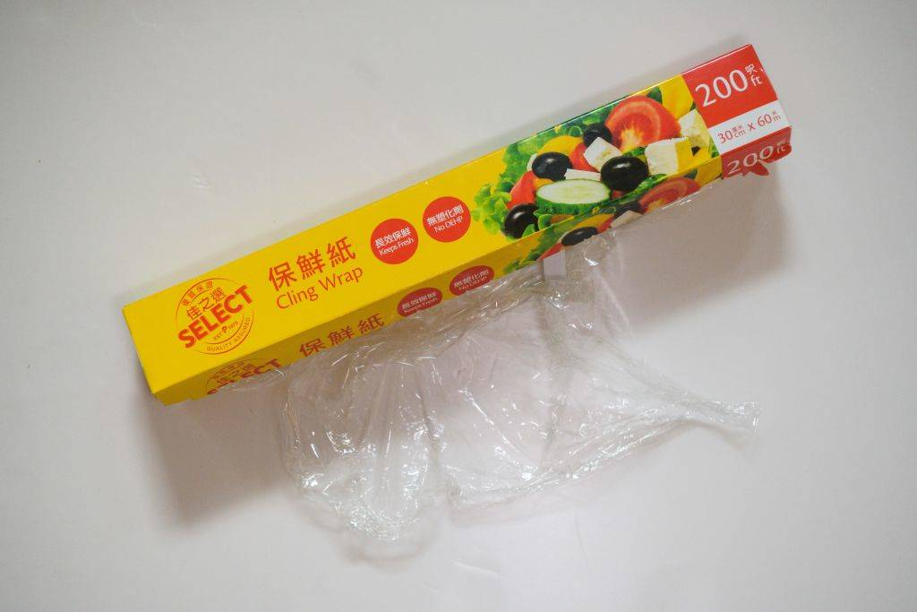 a box of cling wrap with the plastic sticking out