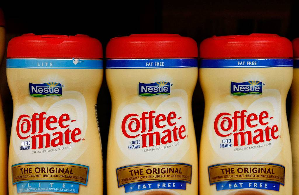 three coffee-mate coffee creamer bottles