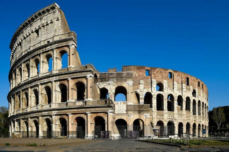 an empty colosseum in rome, italy