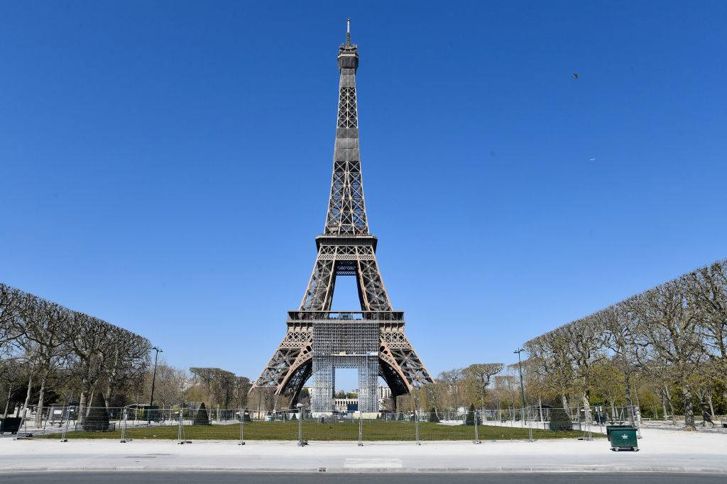 the eiffel tower in paris, france during the day without visitors
