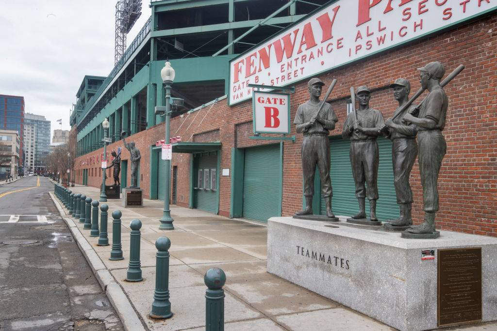 empty entrance to fenway park with baseball player statues