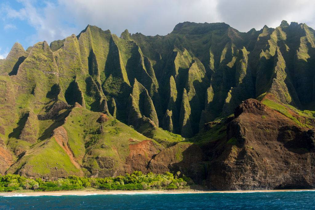 View from an excursion boat of the Na Pali coast on the western side of the Hawaiian Island of Kauai, Hawaii