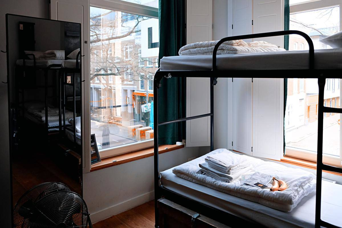 two bunkbeds in a hostel room