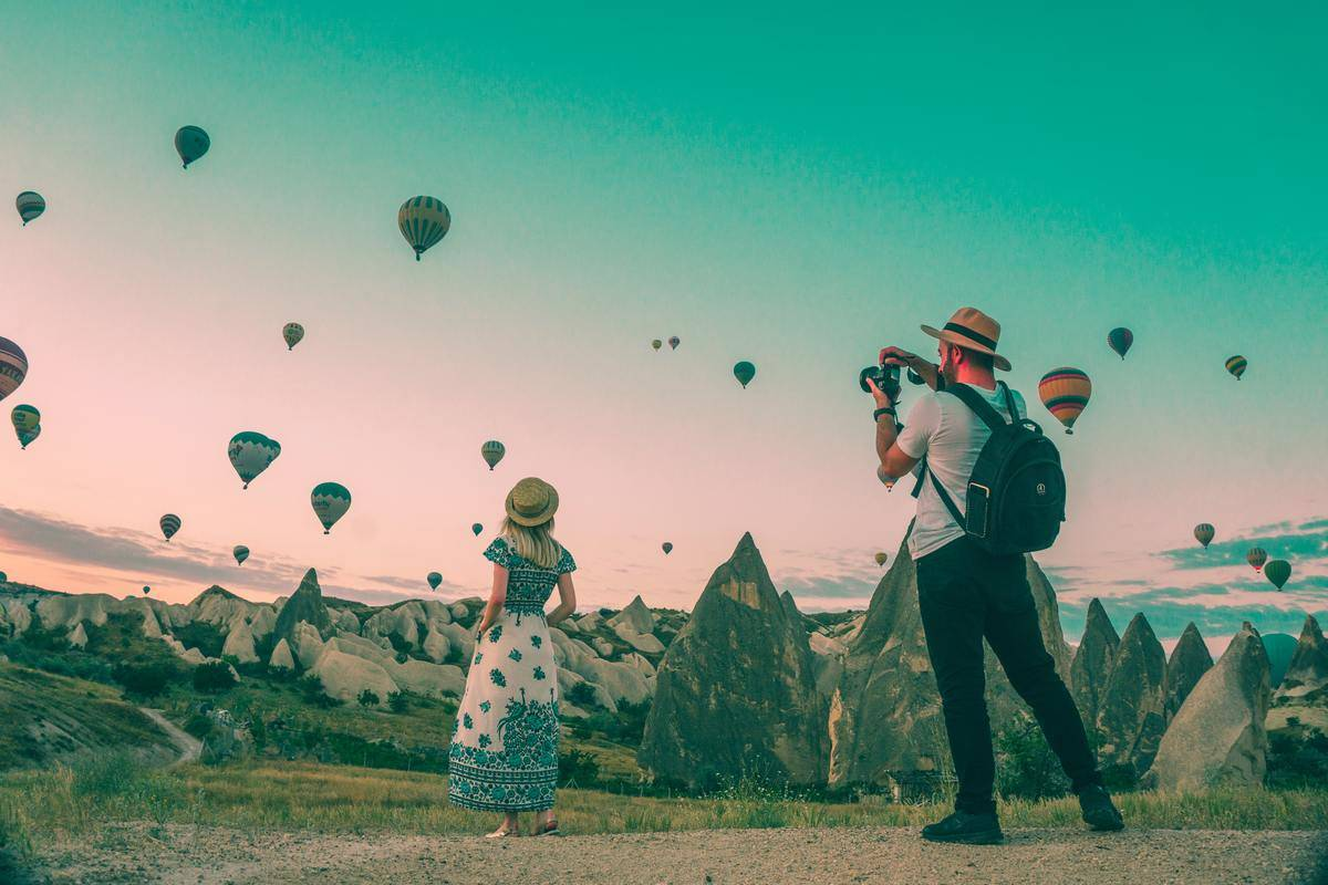 woman standing in hot air balloon area getting photo taken