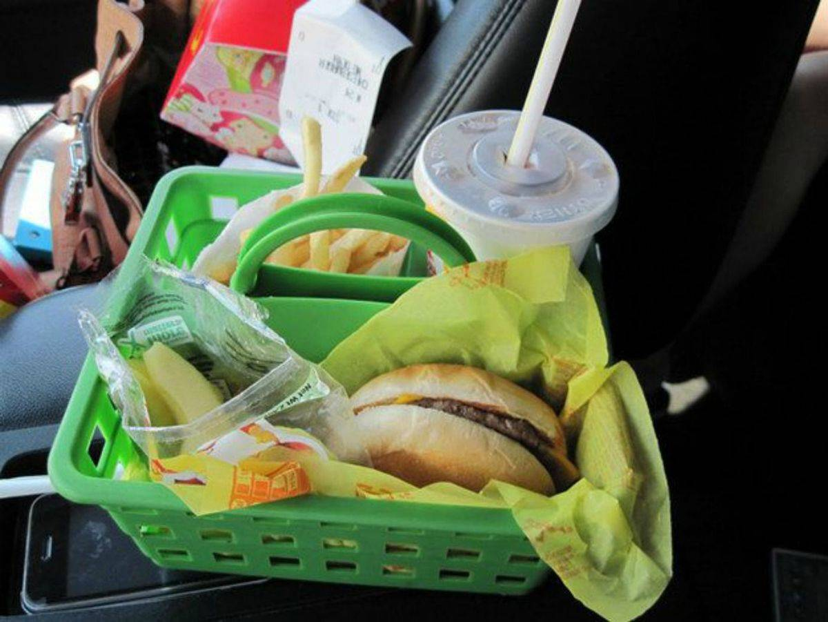 a green shower caddy with fast food inside