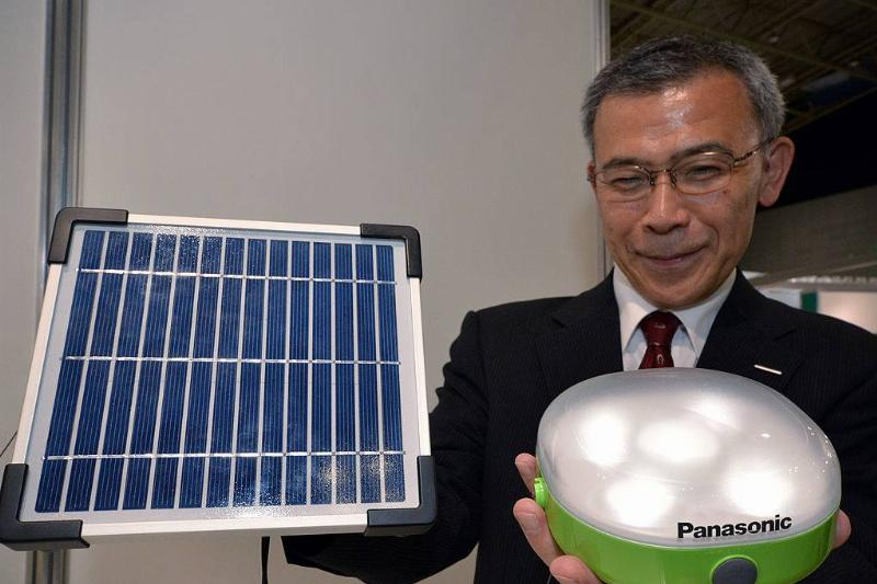Japanese electronics giant Panasonic engineer Kiyofumi Abo displays a prototype of a solar lantern
